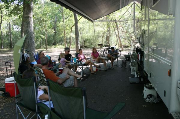Neighboring Campers Enjoying some Football via the Outside Entertainment System on the Satellite TV.